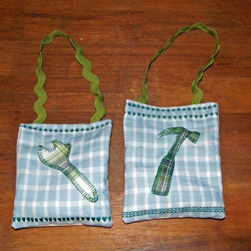 "What makes them ""manly"" lavender bags? Well there's the plaid, and the applique hammer and spanner, plus I added drops of lemongrass and cedar essential oils to the dried lavender, so it smells manly too!"