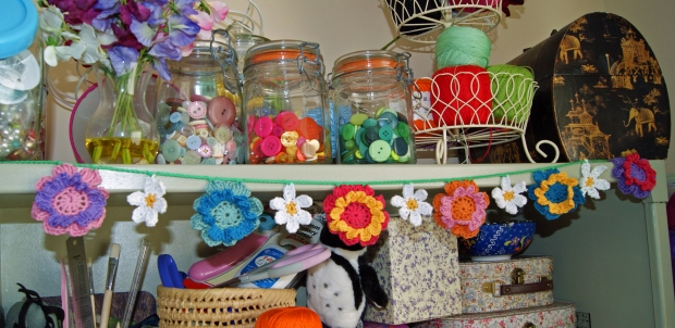 Can you see it amidst all my crafty clutter? I'll give you a clue: it's blooming lovely!