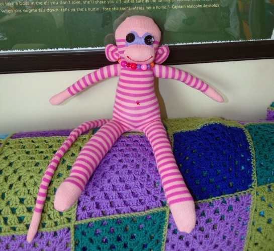 Happy pink sock monkey