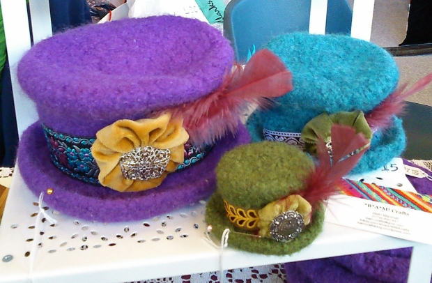 My handmade top hat fascinators with sari trim hat bands and vintage belt buckle detail.