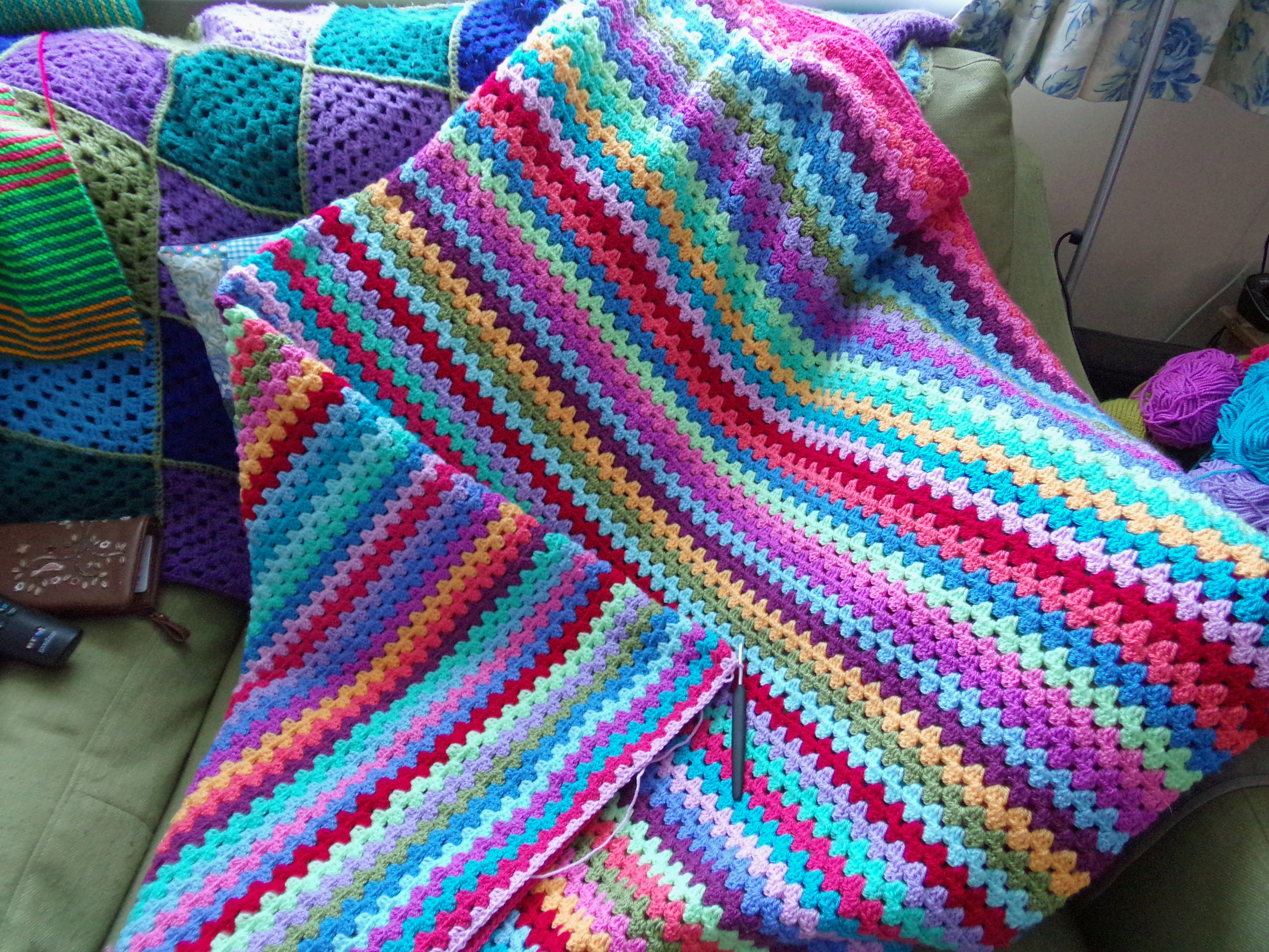 Knitting Blanket Strips : Cracking those wips rainbow raindrops cushion completed