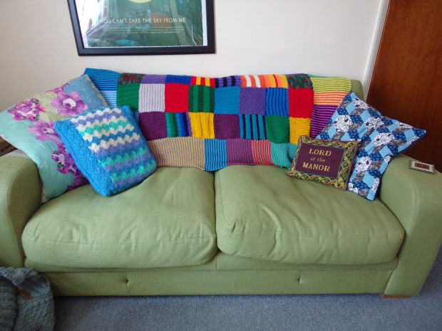 knitted patchwork blanket on sofa