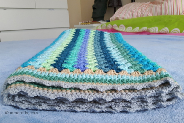 granny stripe crochet blanket folded end